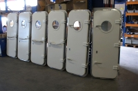 Watertight doors with portholes